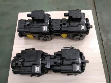 Tandem piston pumps